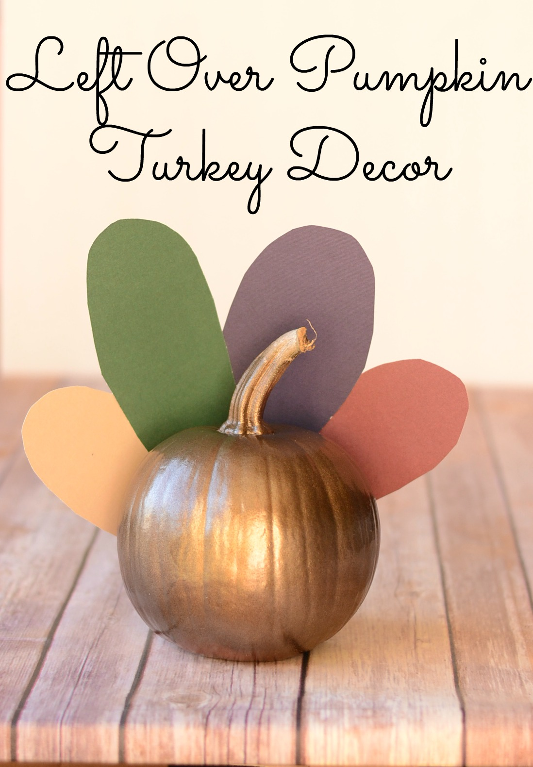 Use leftover Halloween pumpkins to create turkey decor for Thanksgiving. From It Happens in a Blink
