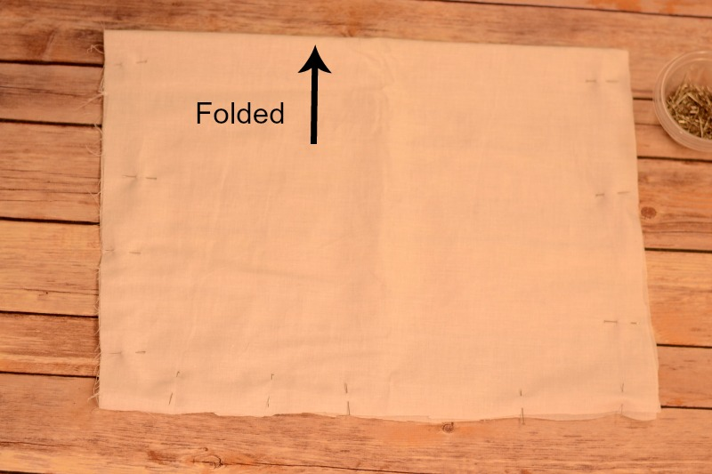 Fold pillow fabric in half