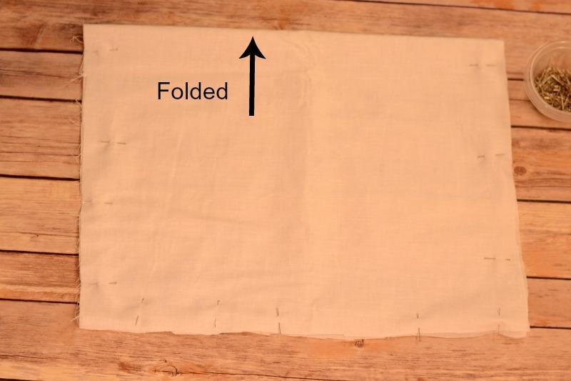Fold pillow fabric in half