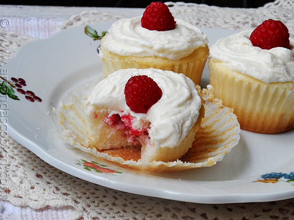 Raspberry Filled White Chocolate Buttercream Cupcakes from Amanda's Cookin'