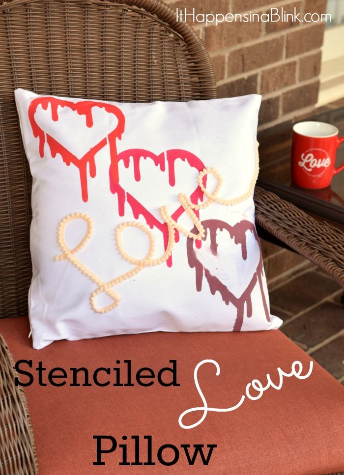 Stenciled LOVE Pillow  |  Use fabric paint, stencils, and pom pom trim to create a heart themed pillow