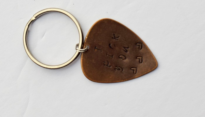 """DIY Metal Stamped """"I Pick You"""" Guitar Pick on a keychain. Perfect gift idea for the special someone in your life for Valentine's Day, an anniversary, or Christmas! AD"""