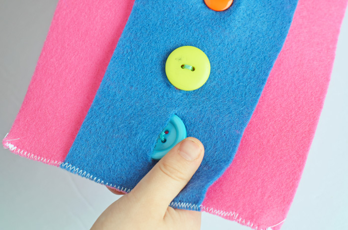 Working on Fine Motor Skills with a Buttons on Felt Activity  AD