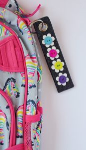 Personalized Backpack Zipper Pull made with heat transfer vinyl flowers AD