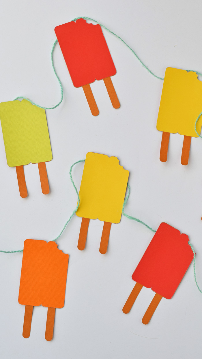 Colorful Summer Popsicle Garland made with the Cricut Explore Air. Cute craft and decor for summer parties! AD