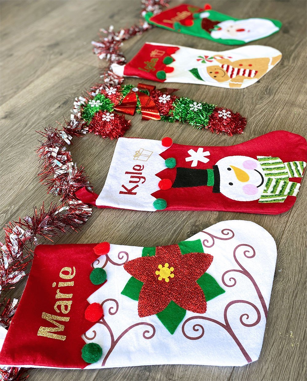 Personalized Christmas stockings made with glitter and the Cricut machine